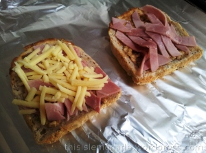 Chunky peanut butter, ham and grated cheese onto lightly toasted bread.